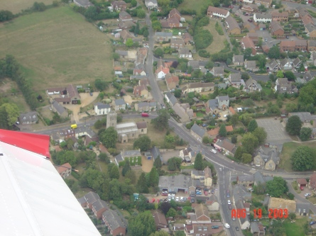 The centre of the village with Castle Road top centre and Olney Road at the bottom.