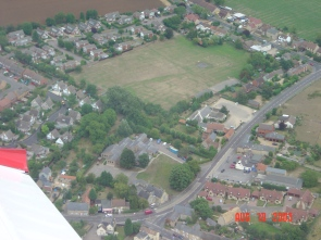 The playing field with Harrold Road, top right, and the war memorial bottom centre