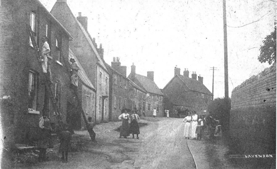 Painting and decorating in Northampton Road before the road was widened.