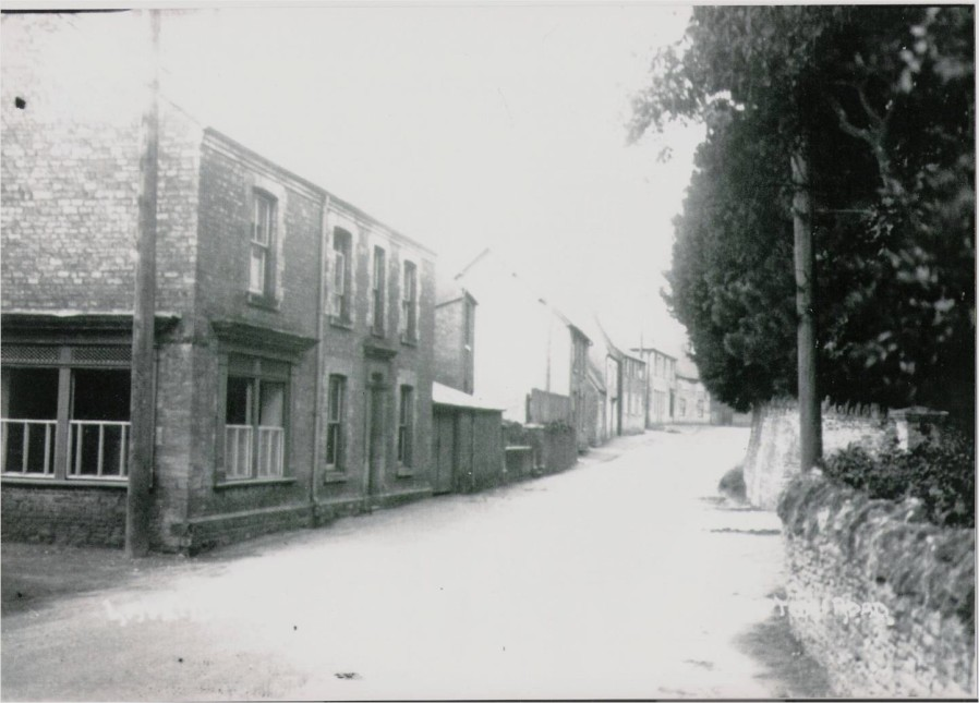 Northampton Road, Lavendon, on a busy day with the former butcher's shop on the left.