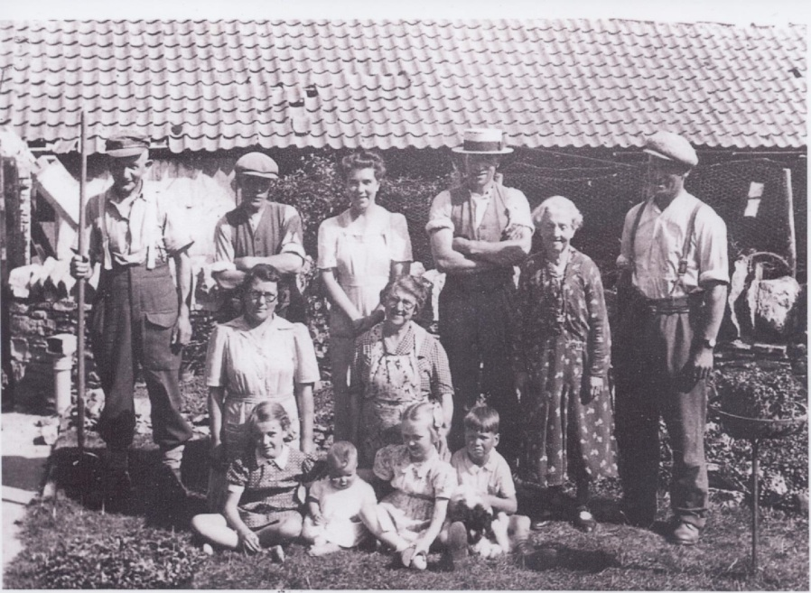 The Ingram Family, formerly of Lower Farm. Iris is standing in the middle at the rear, together with John and Ray Ingram respectively standing on the right.